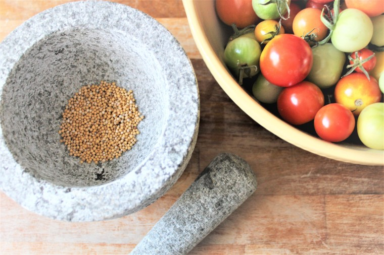 Mustard seeds and tomatoes